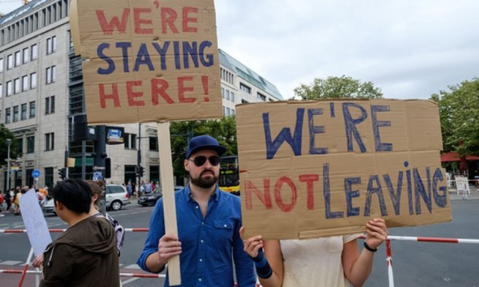 Britons living in Germany hold up signs in protest against Brexit in Berlin last July