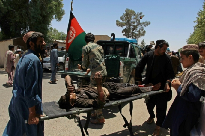 At least 20 killed as car bomb hits bank in south Afghanistan