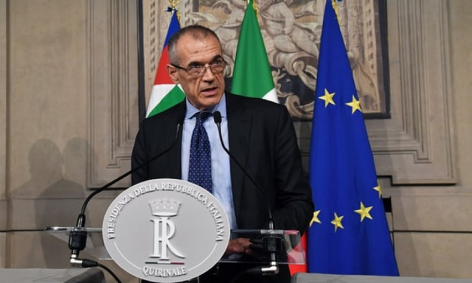 Carlo Cottarelli speaks to the press in Rome after meeting with Italian President Sergio Mattarella. (Photo: Getty Images)