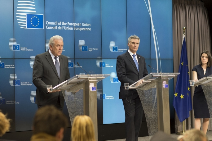 Home Affairs Minister Carmelo Abela and European Commissioner Dimitris Avramopoulos
