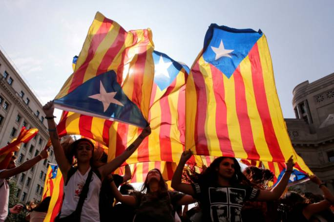 Spain sacks Catalan government after independence declaration, calls snap election
