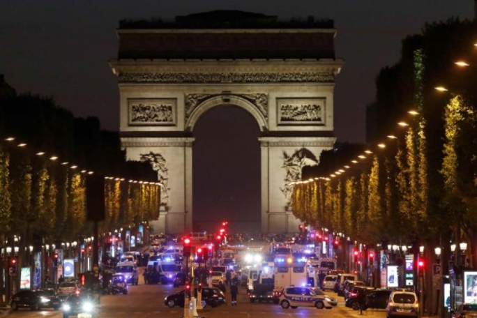 Police secure the Champs Elysees Avenue after the shooting incident in Paris, France
