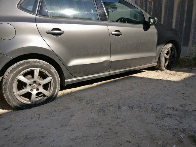 Vandals slashed Charlot Cassar's car tyres and scratched its mudguard (Photo: Facebook)