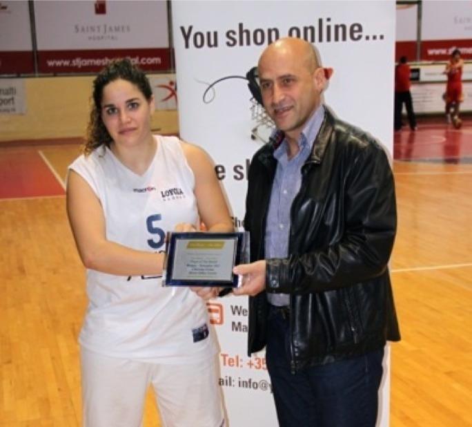 Paul Sultana presenting the award to Christina Grima
