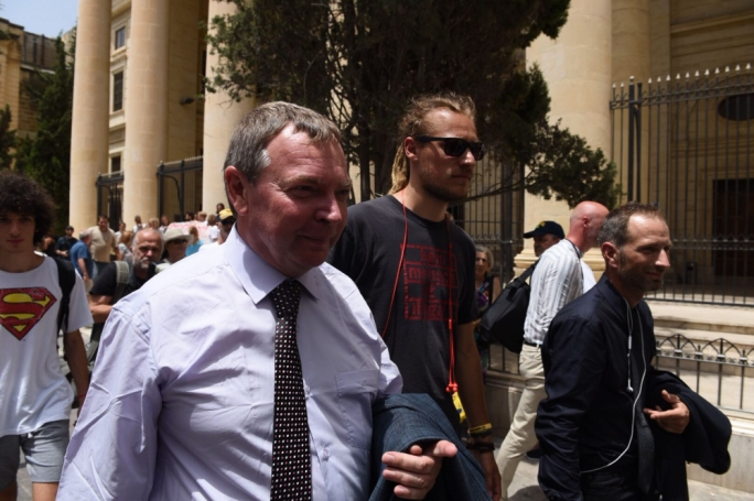 Captain Claus-Peter Reisch (left) exiting the courthouse in Valletta with two activists from the Lifeline (Photo: James Bianchi/MediaToday)