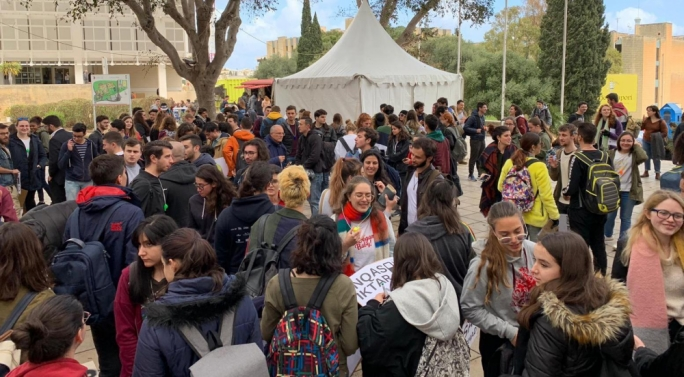 University students congregate on campus before they leave