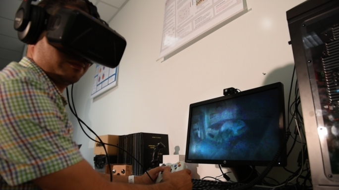 A student at St Martin's demonstrating the virtual reality tour of St Paul's Catacombs