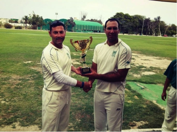 Great Britain captain Derek Ali and Australia/Asia's Sam Aquilina hold the Malta Diplomats Cricket Cup.
