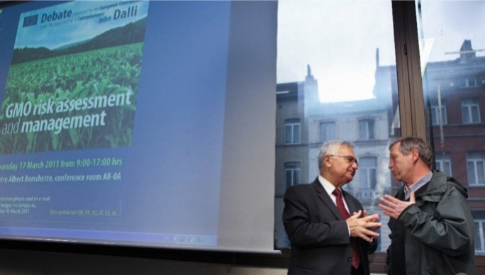John Dalli with José Bové, in discussion after one of his controversial decisions to reverse a GMO crop ban.