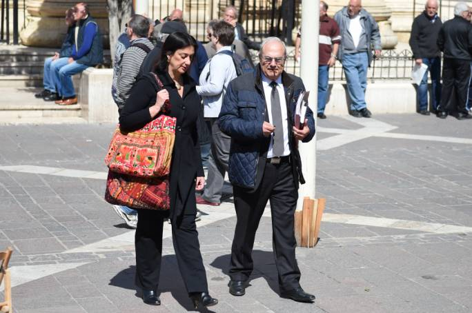 Daphne Caruana Galizia leaving the law courts with her lawyer Joe Zammit Maempel