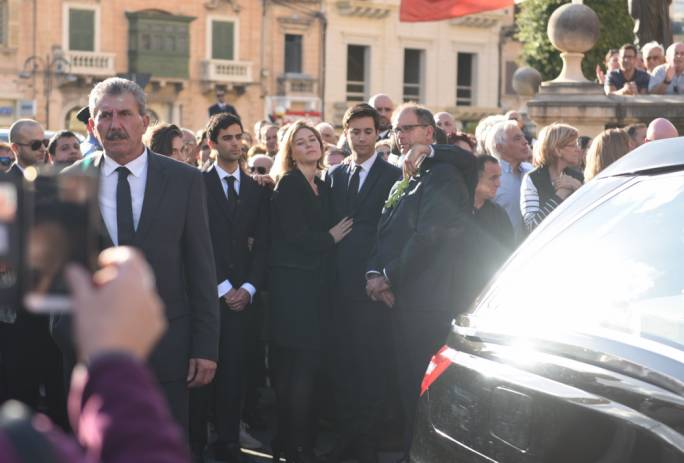 Daphne Caruana Galizia's sons and her husband Peter, outside the Mosta Dome where the funeral for the slain journalist was held. Photo: James Bianchi