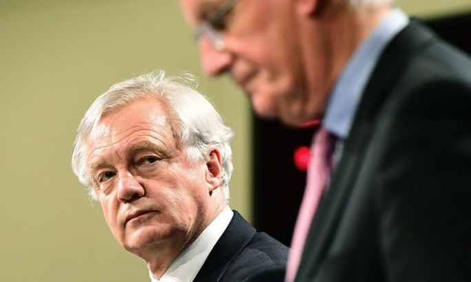 David Davis (left) and Michel Barnier address a press conference at the end of the first day of Brexit talks