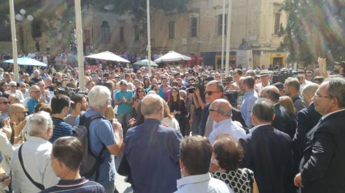 Crowd gathers in front of the law courts in show of support after Daphne Caruana Galizia's murder