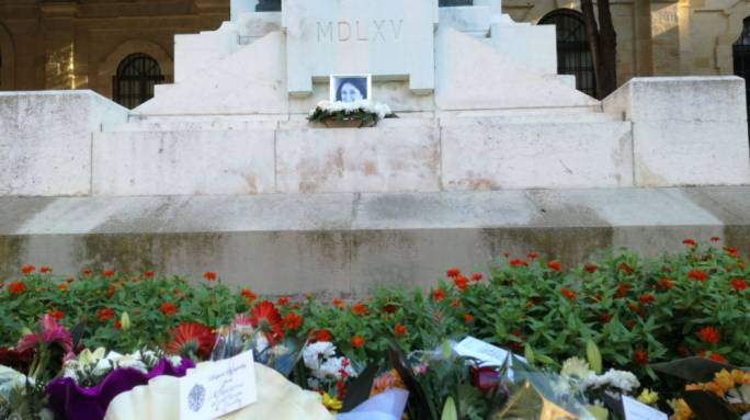A photo of Daphne Caruana Galizia was placed at the foot of the Great Siege monument