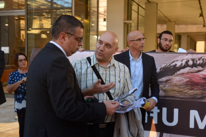 PN leader Adrian Delia was one of the MPs who were handed a factsheet as they walked into the House