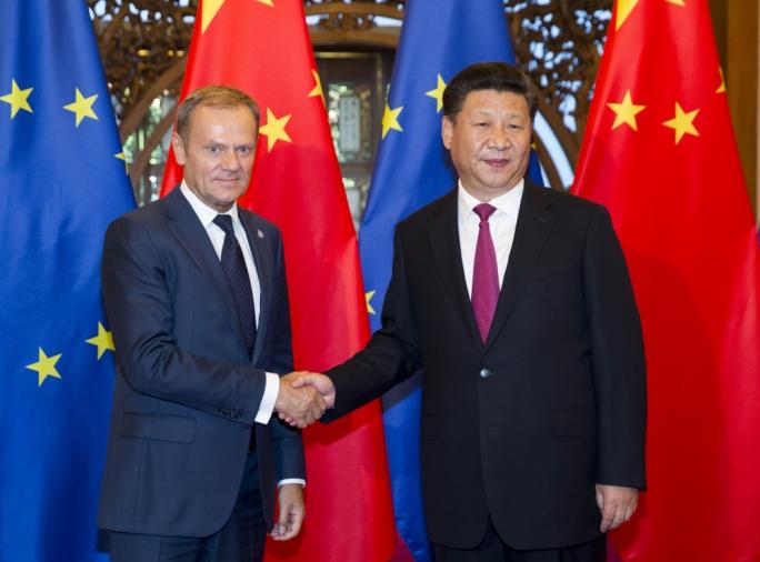 EU Council President Donald Tusk, with Chinese premier Xi Jinping