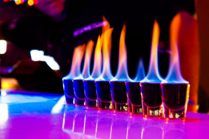 The Paceville barman burned his customers' faces while setting their drinks on fire