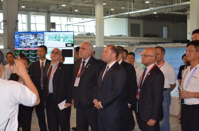 Joseph Muscat touring the Foxconn park with the rest of the Maltese delegation