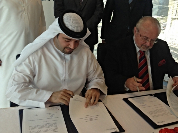 Tonio Casapinta (right) signing an MOU with the Omani Chamber of Commerce