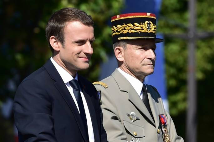 French President Emmanuel Macron (left) and outgoing armed forces chief General Pierre de Villiers, pictured during the annual Bastille Day military parade in Paris on July 14