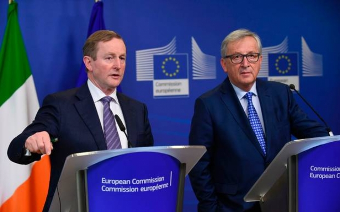 Speaking at a press conference after a meeting with the European Commission President, Jean-Claude Juncker (R), Enda Kenny (L) also said he believed that the triggering of article 50 would be 'delayed a little'