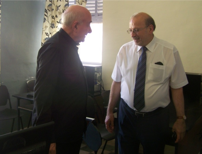 Father Philip shows Governor Josef Bonnici the new computer room at the refugee centre in Balzan.