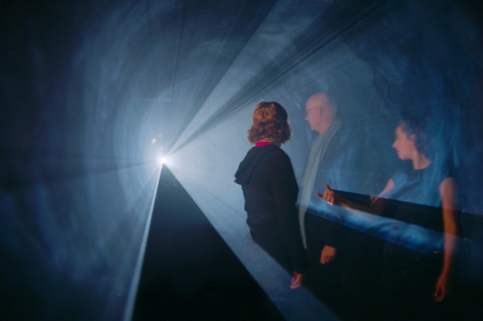 Photo taken during a showcase of Anthony McCall's Line Describing a Cone