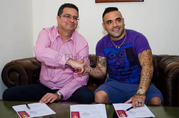 Fabrizio Miccoli signing for Birkirkara in July 2015, shaking hands with then club president Adrian Delia