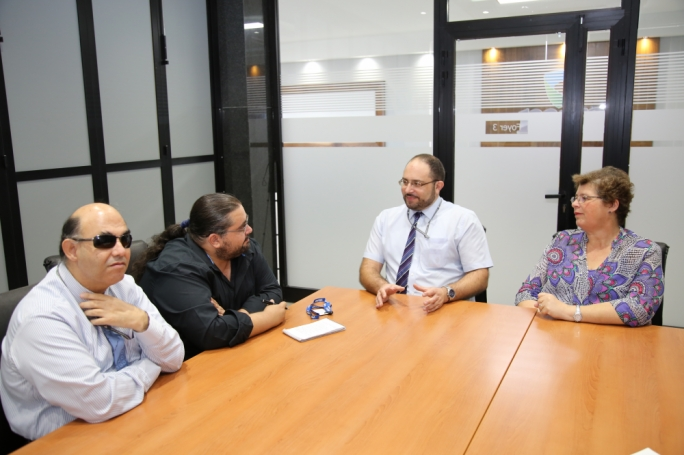From right: FITA chairperson Elizabeth Olivieri, and CEO Stanley Debono, speaking to Paul Cocks. Left: Michael Micallef, head of human resources and IT accessibility