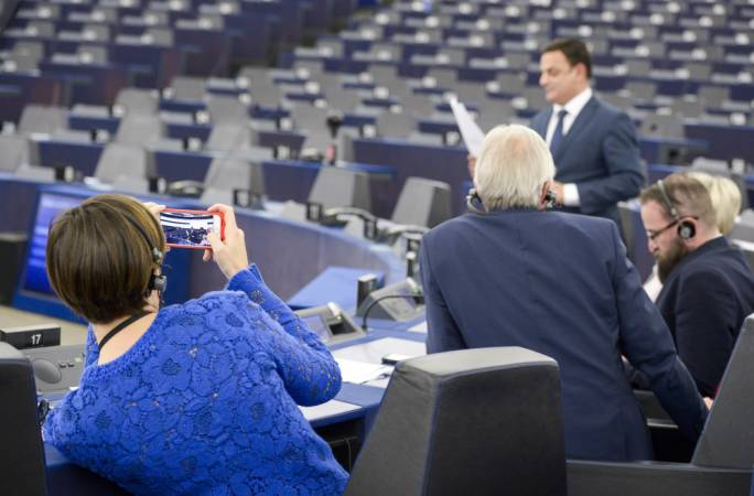 Italian MEP Lara Comi (EPP) snaps a mobile phone photograph of Nationalist MEP David Casa during his intervention in the rule of law debate on Malta