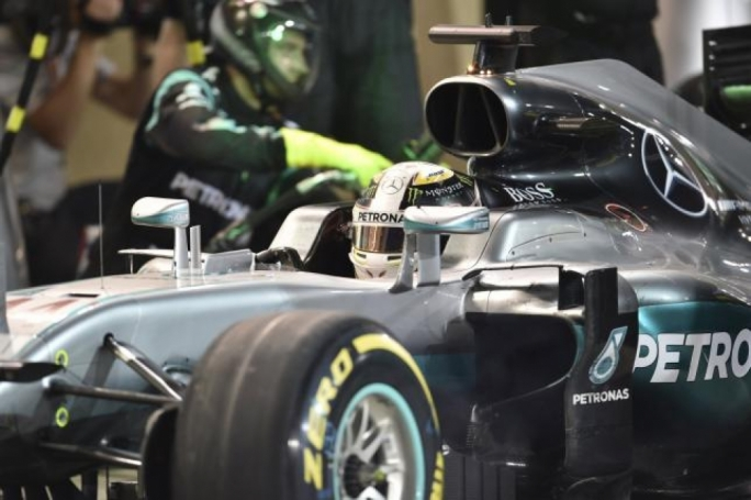 Mercedes F1 driver Lewis Hamilton of Britain sits in his car in the pits