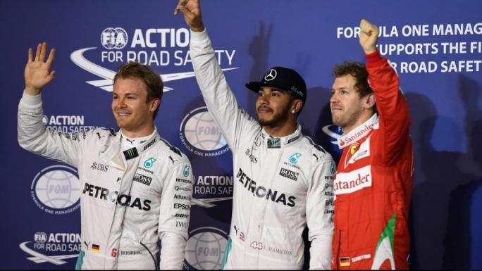 (L to R): Nico Rosberg (GER) Mercedes AMG F1, pole sitter Lewis Hamilton (GBR) Mercedes AMG F1 and Sebastian Vettel (GER) Ferrari celebrate in parc ferme at Formula One World Championship, Rd2, Bahrain Grand Prix Qualifying, Bahrain International Circuit, Sakhir, Bahrain, Saturday 2 April 2016