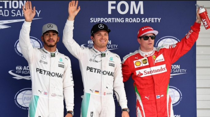 (L to R): Lewis Hamilton (GBR) Mercedes AMG F1, pole sitter Nico Rosberg (GER) Mercedes AMG F1 and Kimi Raikkonen (FIN) Ferrari celebrate in parc ferme at Formula One World Championship, Rd17, Japanese Grand Prix, Qualifying, Suzuka, Japan