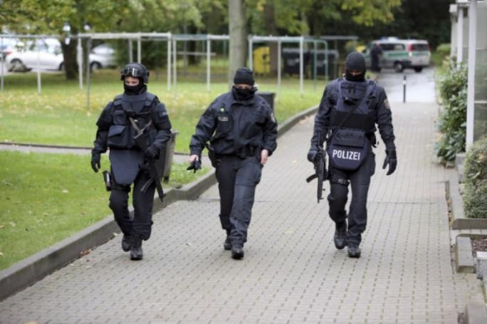 German special police officers search the eastern City of Chemnitz on suspicion that a planned bomb attack was being planned in Germany.