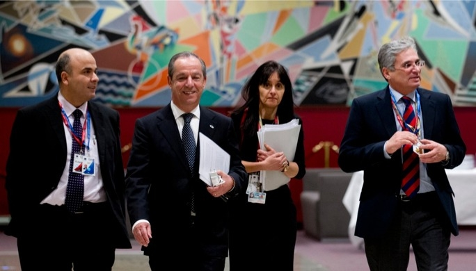 Prime Minister Lawrence Gonzi (centre) with personal assistant Leonard Callus (left) and permanent representative Marlene Bonnici and EU advisor Richard Cachia Caruana (right).