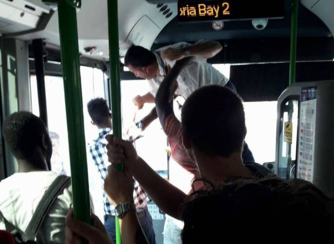 The passengers shown in the photo were trying to break up the fight (Photo: Facebook/Waqfet tal-Linja)