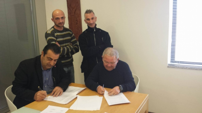 GWU section secretary David Darmanin (left) and managing director Frank Spiteri signing the collective agreement