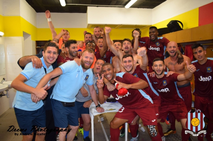 Gżira United players celebrate in the dressing room after beating Sant Julia