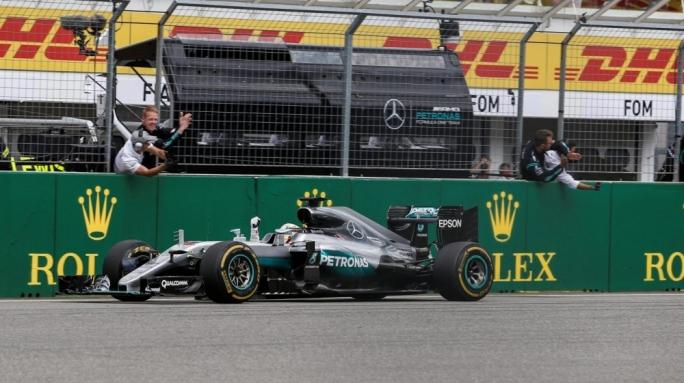 Lewis Hamilton crosses the finish line