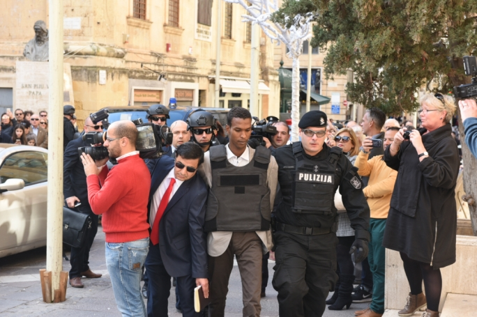 If any aspect may be described as 'artificial' or 'exaggerated', it was the scene of the arraignment of the two hijackers: which called to mind the mass-arraignments of top Sicilian Mafiosi in the Falcone era.