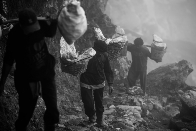 The volcano is the livelihood of sulphur miners who climb the cliff face twice a day in search of sulphur rocks