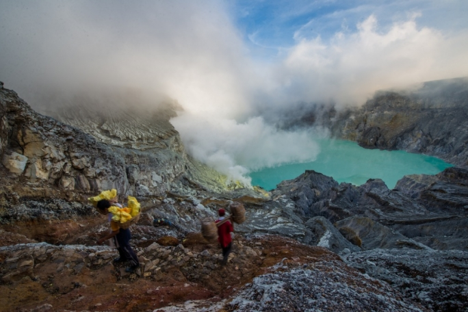 What makes Volcano Ijen stand out from the crowd is the turquoise-coloured acid-filled crater lake and the famous blue flames