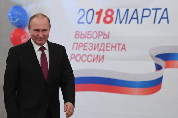 Putin secures six more years with record win