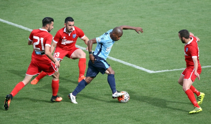 Denni Dos Santos of Sliema trying to hold on to possession. Photo: Dominic Borg