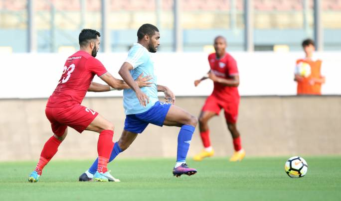 Jefferson De Assis (Sliema) trying to hold on to possession while being challenged by Elkin Serrano Valero (Balzan). Photo: Dominic Borg