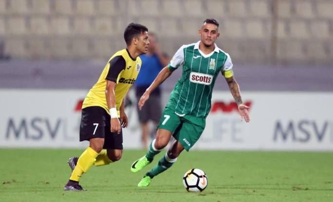 Steve Pisani (Floriana) and Jackson Lima Siqueira (Hibs) in action. Photo: Dominic Borg
