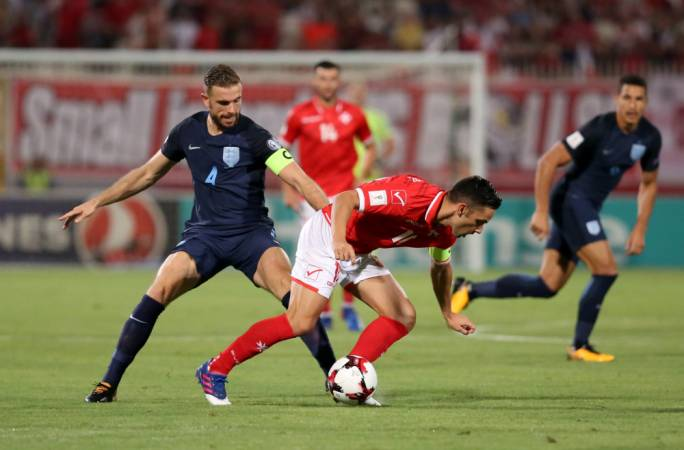 Jordan Henderson challenging Andre Schembri for the ball. Photo: Christine Borg