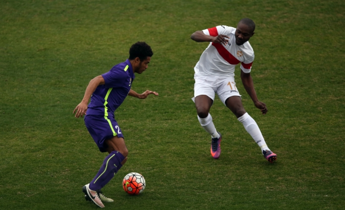 Alfred Effiong of Balzan challenging Emny Pena Beltre for the ball. Photo: Dominic Borg