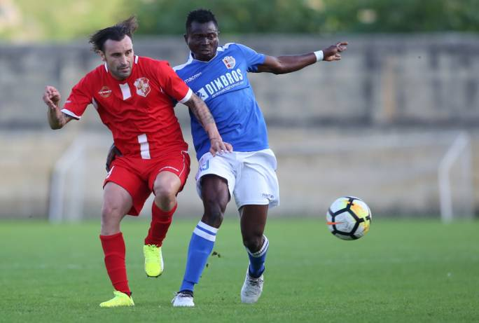 Manolito Micallef (Naxxar) and David Nworah (Mosta) challenging each other for the ball. Photo: Christine Borg