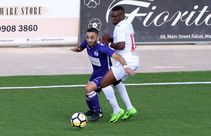 Aidan Friggieri (St Andrews) and Umeh Uchenna Calistus (Valletta) in action. Photo: Dominic Borg